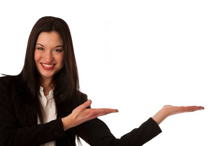 Beautiful asian business woman pointing into copy space - sales person advertising a product isolated photo