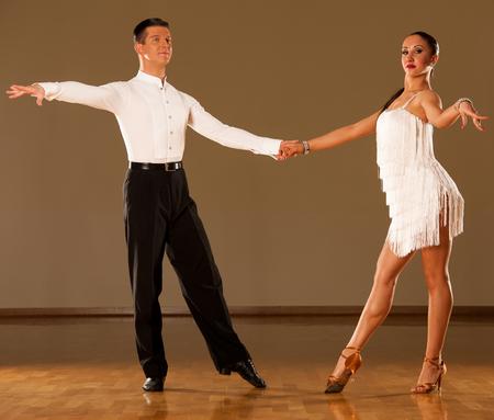 sexy girl dance: latino dance couple in action - dancing wild samba Stock Photo