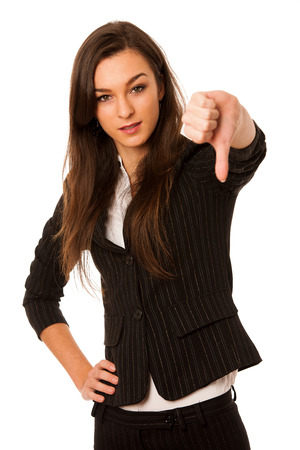 angry business woman showing thumb down isolated over white photo