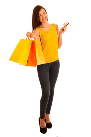 Portrait of young happy smiling woman with shopping bags, isolated over white background photo