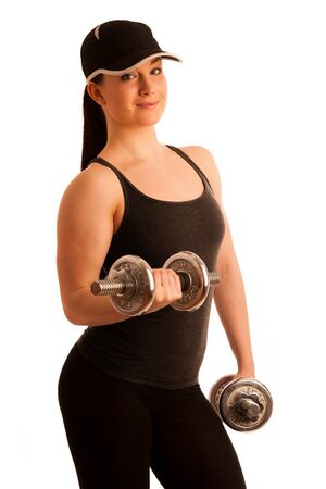 Beautiful young woman working out with dumbels in fitness gym photo