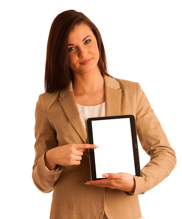 Business woman holding a tablet computer - isolated over a white background photo