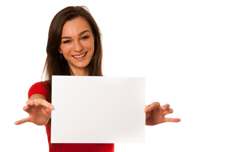 Beautiful young business woman showing a blank card isolated over white photo