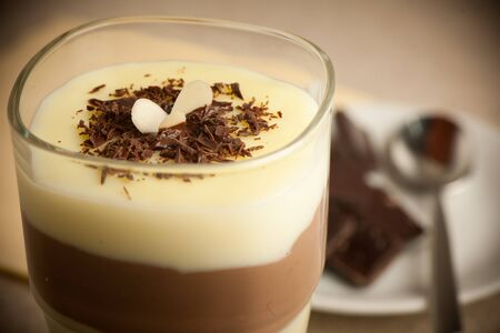 vanilla pudding: Mixed chocolate and vanilla pudding served in a glass decorated
