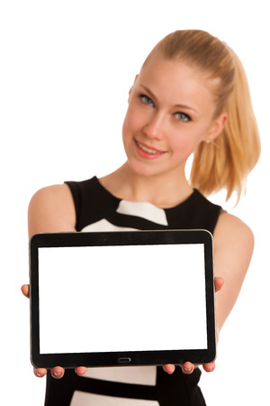 Beautiful young caucasian business woman with blond hair working on tablet photo
