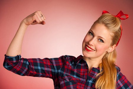 pins: Beautiful young blond Pinup woman gesturing we can do it over red background