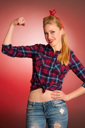 Beautiful young blond Pinup woman gesturing we can do it over red background photo