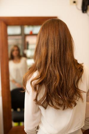 hair treatment: Hairdresser making hair treatment to a customer in salon