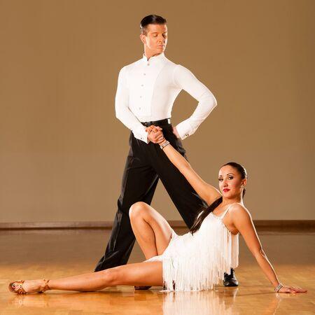 latino dance: latino dance couple in action - dancing wild samba Stock Photo