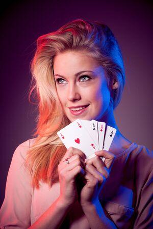 casino table: Beautiful caucasian woman with poker cards gambling in casino
