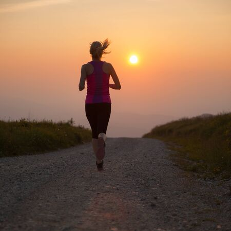 woman run: beautiful young woman runns on a mountian path at sunrise