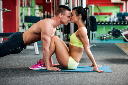 gym girl: Fitness youple workout - fit mann and woman train in gym