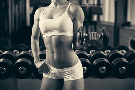 fitness abs female: Beautiful fit woman working out in gym