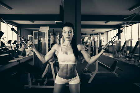 Beautiful fit woman working out in gym