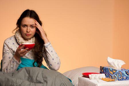 head ache: Asian caucasian woman having a head ache