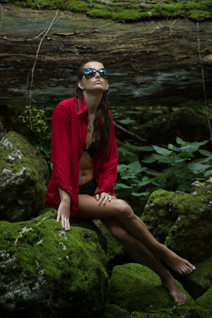 sexy female body: Fashionable woman in dark forest near river Stock Photo