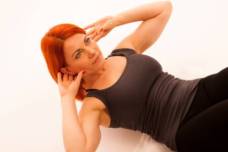 situp: woman working out in fitness doing situp Stock Photo