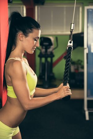 intervals: Beautiful fit woman working out in gym