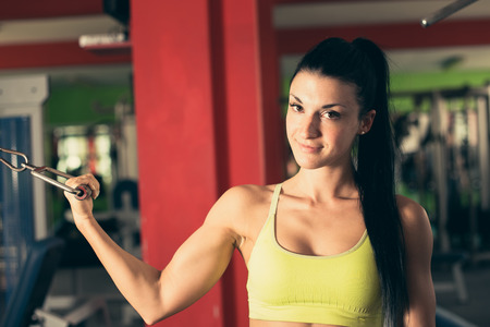 working woman: Beautiful fit woman working out in gym