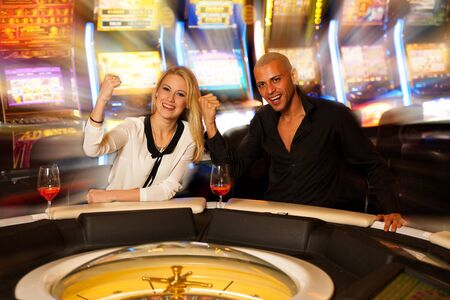 roulette player: couple playing roulette in casino