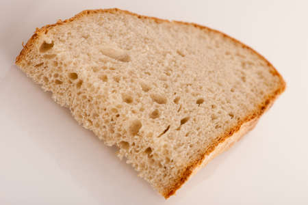 fresh baked: Slice of fresh baked bread made of cereal flouer isolated over white background.