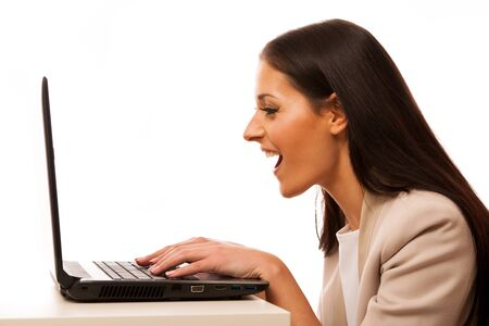 looking into: Excited woman looking into laptop computer. Stock Photo