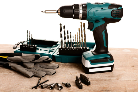 silver plated: Tool set of screwdriver bits with different nozzles on wooden desk.