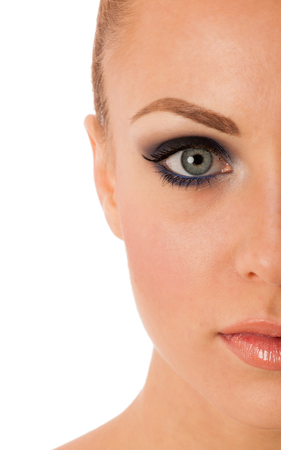 antiaging: Beauty portrait of woman with perfect makeup, smokey eyes, full lips thinking about anti-aging facial surgery. Stock Photo