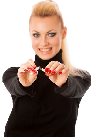 habbit: Happy woman gesturing quitting stinky unhealhy habbit by breaking cigarette decided to quit smoking.
