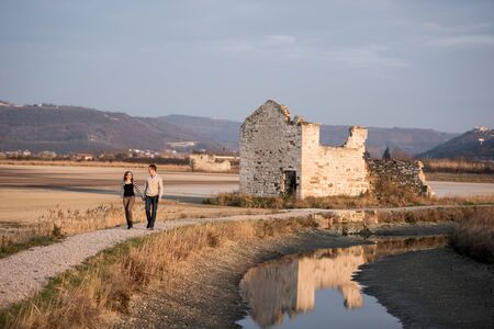 salina: Couple in love on engagement day on a walk in romantic natural park Secovlje salina.
