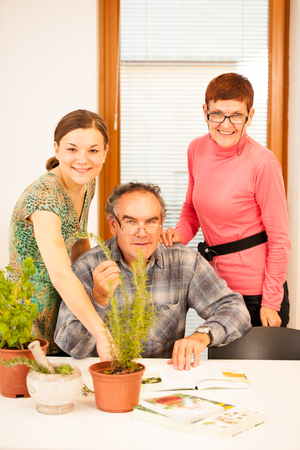 intergenerational: Workshop of knowing herbs, touching and smelling basil and thym. Intergenerational transfer of knowledge.