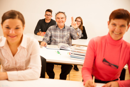 lifelong: Group of people of different age sitting in classroom and attending a school for adults. Lifelong learning. Stock Photo