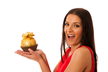 received: Happy woman holding big chocolate candy received as a gift.