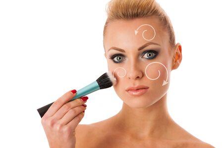 full lips: Portrait of woman holding beauty accessories, mascara, pauder brush, lipstick, for perfect makeup, smokey eyes, full lips.