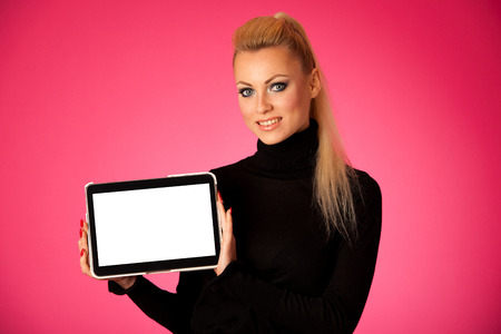 blanck: Woman holding tablet computer with blanck screen for commercial, promotion, advertising message.