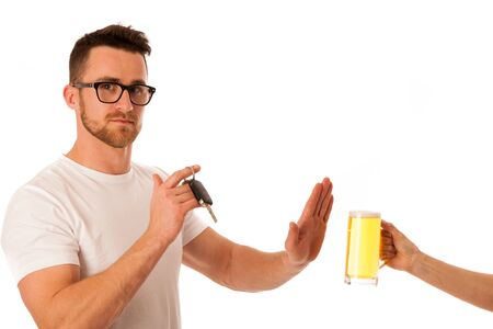drink and drive: Man refusing alcohol beer showing car key as gesture of dont drink and drive isolated over white.