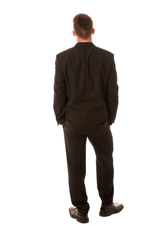 confidently: Successful businessman in formal suit confidently standing isolated over white. Stock Photo