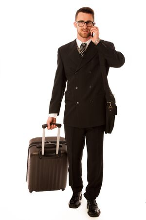trip over: Successful businessman in formal suit and briefcase going on business trip isolated over white.