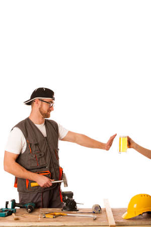 refusing: Handyman in work clothing refusing beer, dont drink on workplace isolated.