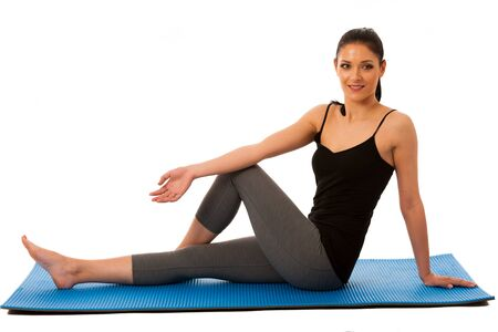 abductor: Beautiful fit hispanic woman doing stretching excercise isolated over white