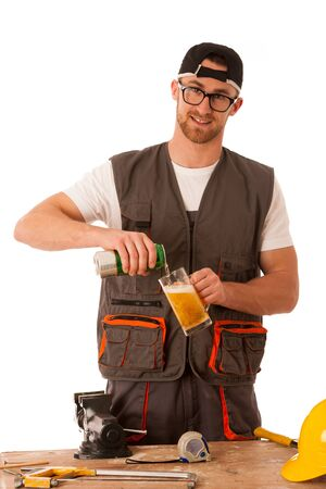 break from work: Handyman in work clothing having a break, drinkng beer isolated over white.