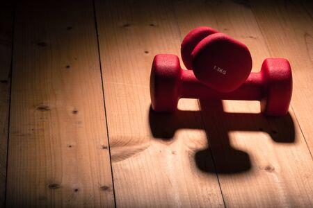 flor: dumbbells on a wooden flor in gym Stock Photo