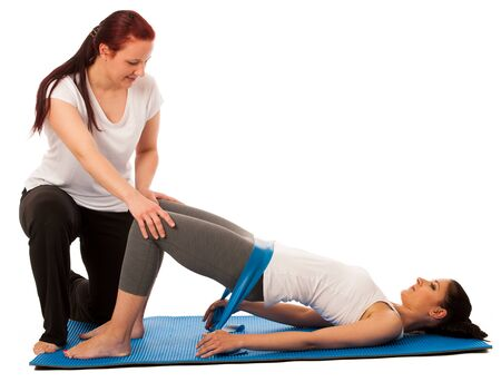 strenght: Physiotherapy - therapist doing   excercises with band for improving back strenght and stability with a patient to recover  after injury isolated