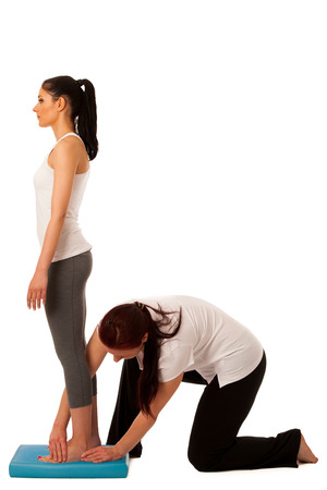 Physiotherapy - therapist doing   excercises for improving coordination and stability with a patient to recover  after injury