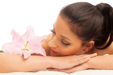 rejuvenating: Beautifulyoung woman having a rejuvenating massage in a wellness studio - spa Stock Photo