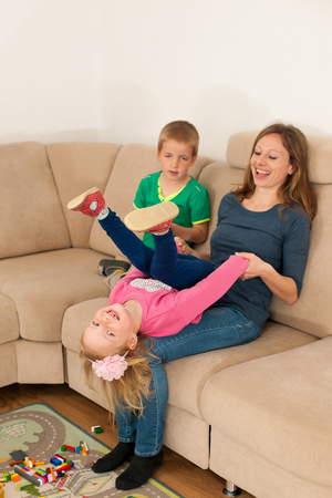 female child: Mother is playing with her daughter in living room