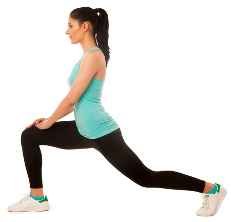 girl squatting: Beautiful young hispanic woman doing lunge exercise in fitness gym isolated over white background Stock Photo