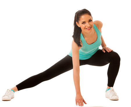 lunge: Beautiful young hispanic woman doing lunge exercise in fitness gym isolated over white background Stock Photo