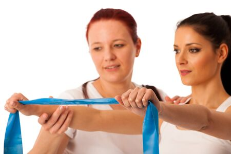 strenght: Physiotherapy - therapist doing arm strenghteninh excercises with a patient to recover strenght after injury Stock Photo