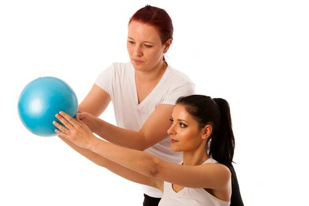 Physiotherapy - therapist doing arm  excercises for improving coordination with a patient to recover  after injury Stock Photo